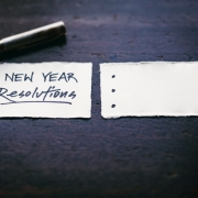 "Pen and Paper with ""New Years Resolution"" Written"