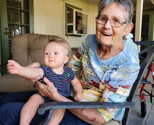 Woman who uses ECG products holding grandchild.